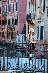 happy young traveller woman in Venice, Italy in winter