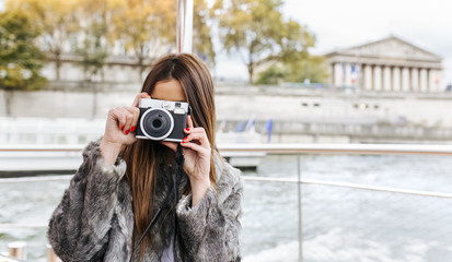 Paris, France, tourist taking picture with camera on Seine River