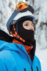 Skier standing and looking away on snowy landscape