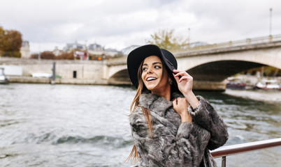 Paris, France, smiling woman taking a cruise on Seine River
