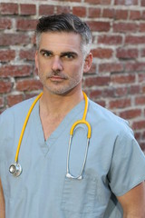 Doctor with stethoscope portrait isolated