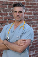 Mature handsome doctor portrait isolated
