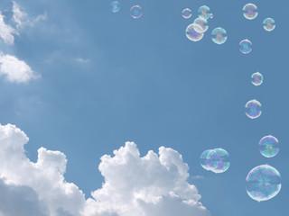 Lightness, fresh air and freedom. Soap bubbles drift over blue sky. Concept.