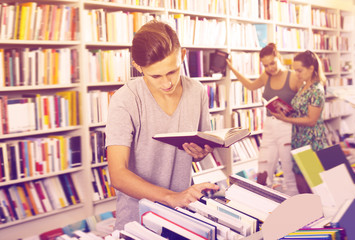 Portrait of cheerful boy looking at open book