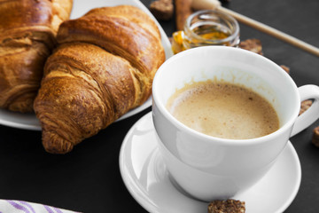 Coffee cup with croissants breakfast meal