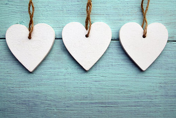 Decorative White Wooden Hearts On A Blue Rustic Background With Copy Space