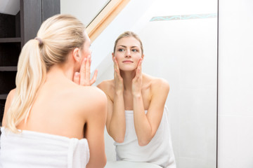 Woman From Shower Looking Herself at the Mirror