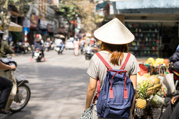 Young traveler with backpack at old quarter in Hanoi