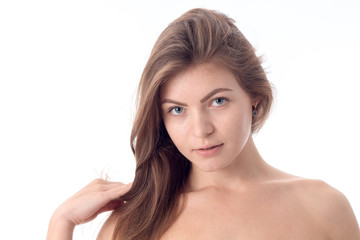young girl without makeup looks straight close-up