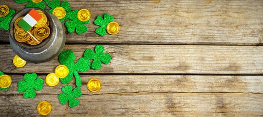 Composite image of shamrock, coins and irish flag