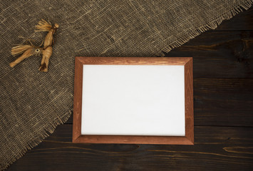 Frame on a wooden background with a toy.