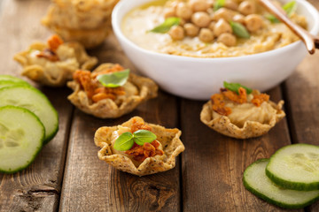 Homemade hummus in tortilla bowls