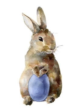 Watercolor Easter bunny with colored egg. Hand painted card with traditional symbols isolated on white background. Cute baby rabbit illustration for design.