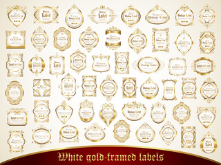 Large collection of white gold-framed labels in vintage style