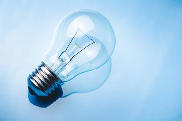 Modern light bulb. Electricity background.