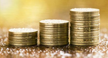 Golden coins closeup - website banner of money savings concept