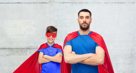 man and boy wearing mask and red superhero cape
