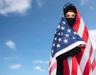 muslim woman in hijab with american flag