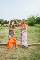 Happy hippie women having fun together