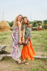 Young girls in hippie style having fun