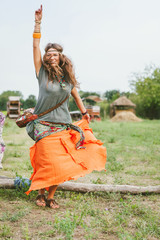 Young woman dancing on the field