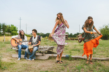 Young group of friends in hippie style having fun