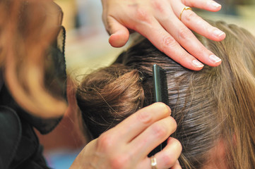 Hairdresser styling hair at the salon