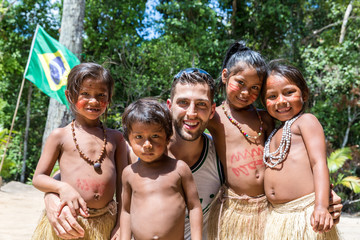 Young man taking photos with Brazilian native tribe