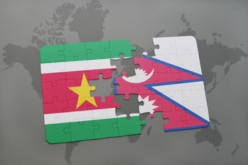 puzzle with the national flag of suriname and nepal on a world map