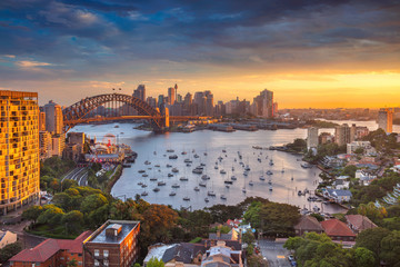 Keuken foto achterwand Australië Sydney. Cityscape image of Sydney, Australia with Harbour Bridge and Sydney skyline during sunset.