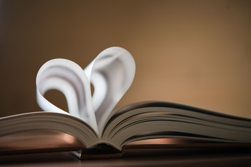 Close up heart shape from paper book concept for valentine's day.
