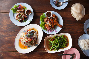 Street food Papaya salad, Grilled Chicken and Pork, Fried morning glory at Thailand market