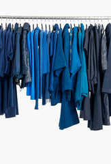 Set of female dress and trousers, coat  isolated on hanging