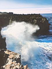 Giant wave breaks on rock. Vintage digital illustration of huge ocean power