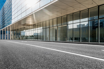 empty asphalt road along modern business buildings in city of China.