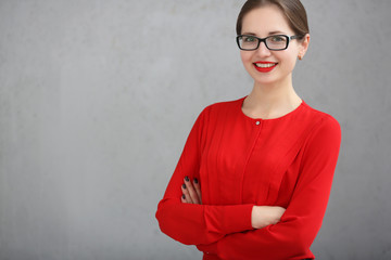 Fashion business woman with a red shirt and glasses portrait