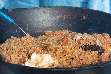 Cooking Uzbek pilaf