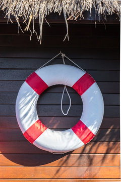 Lifebuoy on Wooden Wall Background