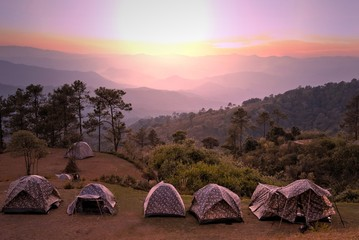 Camping tents on the top of mountain during beautiful sunset at Huai Nam Dang National Park, Chiang mai, Thailand