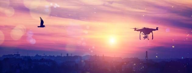 drone in the sky at majestic colorful sunset. over the evening citi. soft light effect, instagram toning effect
