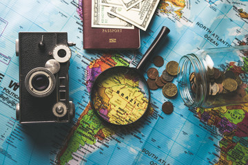 Concept of travel. Money, camera, passport, sunglasses on wooden background. accessories for travelling. copy space