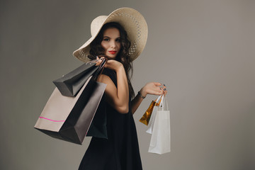 Woman with shopping bags Wall mural