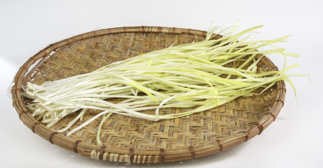 Yellow leek on a bamboo basket