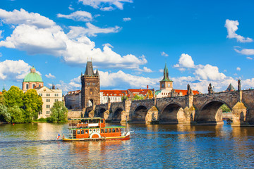 Poster Praag Prague, Czech Republic, Charles Bridge across Vltava river on which the ship sails