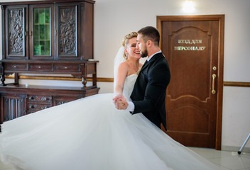 Groom looks at bride with love while they dance in the first time