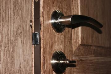 door handle on a door brown structure