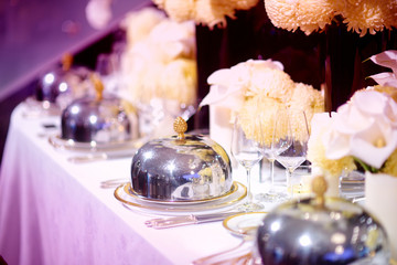Beautiful table setting with crockery and flowers for a party, wedding reception or other festive event