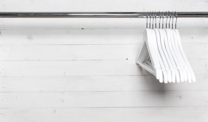 White wooden hangers on the side