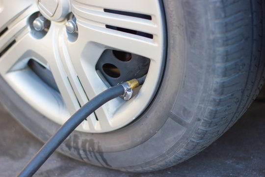 Rubber Hose  Fill tire Filling air into a car tire to increase pressure