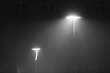 two lanterns in a misty winter evening - black and white